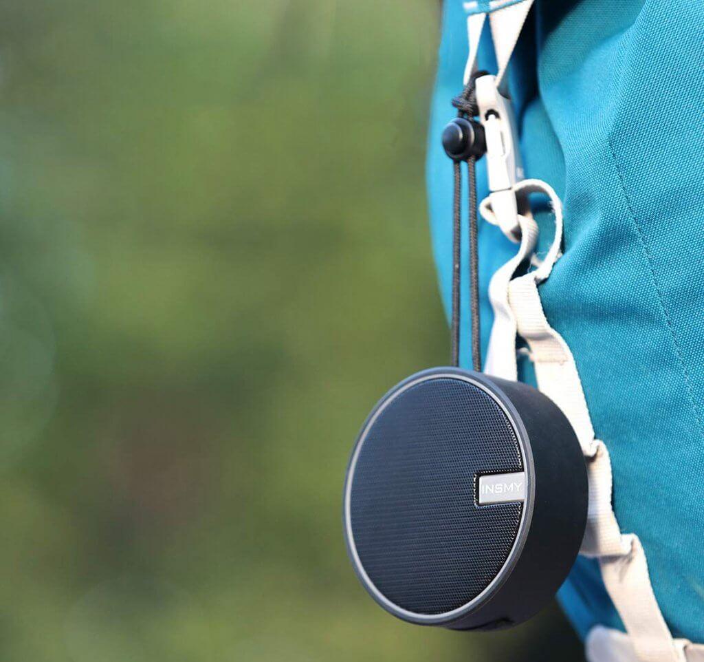 INSMY Portable Bluetooth Shower Speaker on backpack