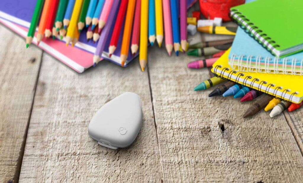 Jiobit GPS Tracker next to pencils