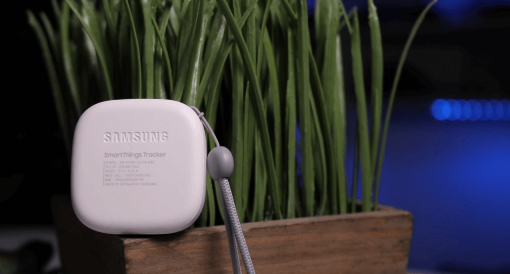 Samsung SmartThings Tracker next to plant