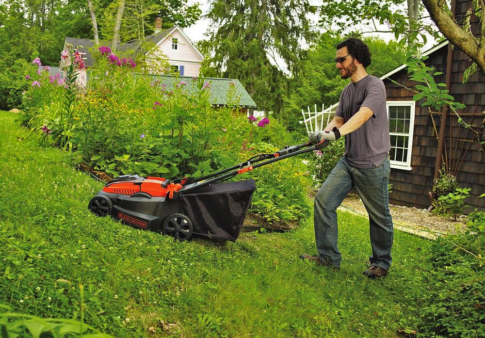 Black+Decker 16-Inch 40-Volt Cordless Lawn Mower on hill