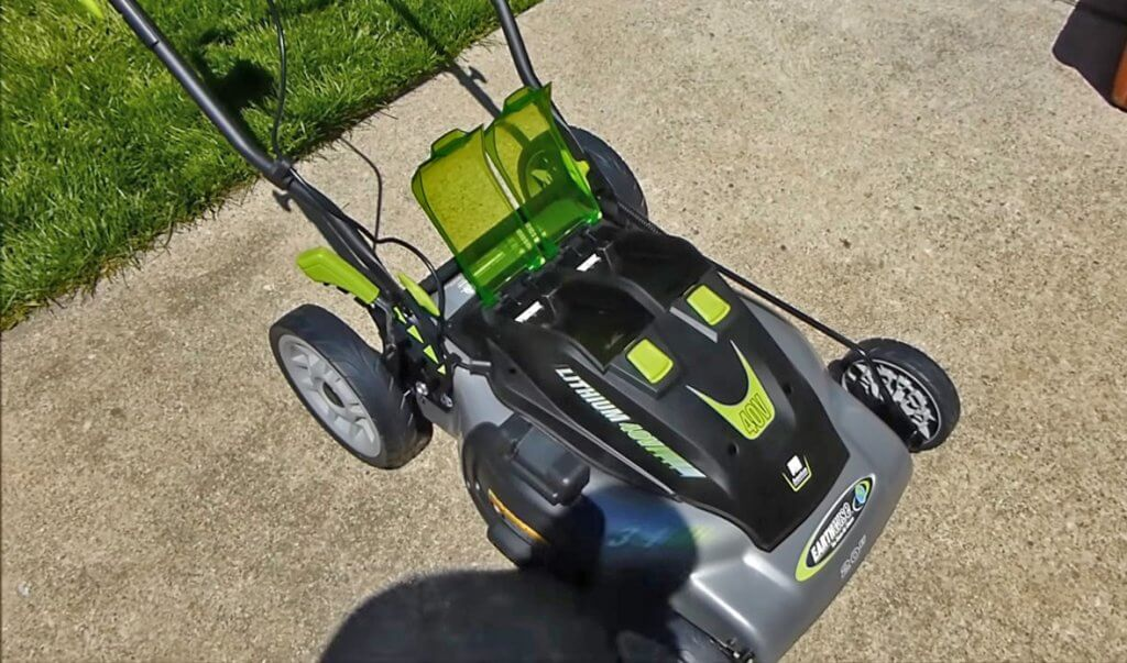 Earthwise 20-Inch Cordless Lawn Mower in front of garage