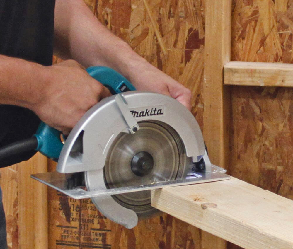 Makita 5007F Circular Saw cutting into wood