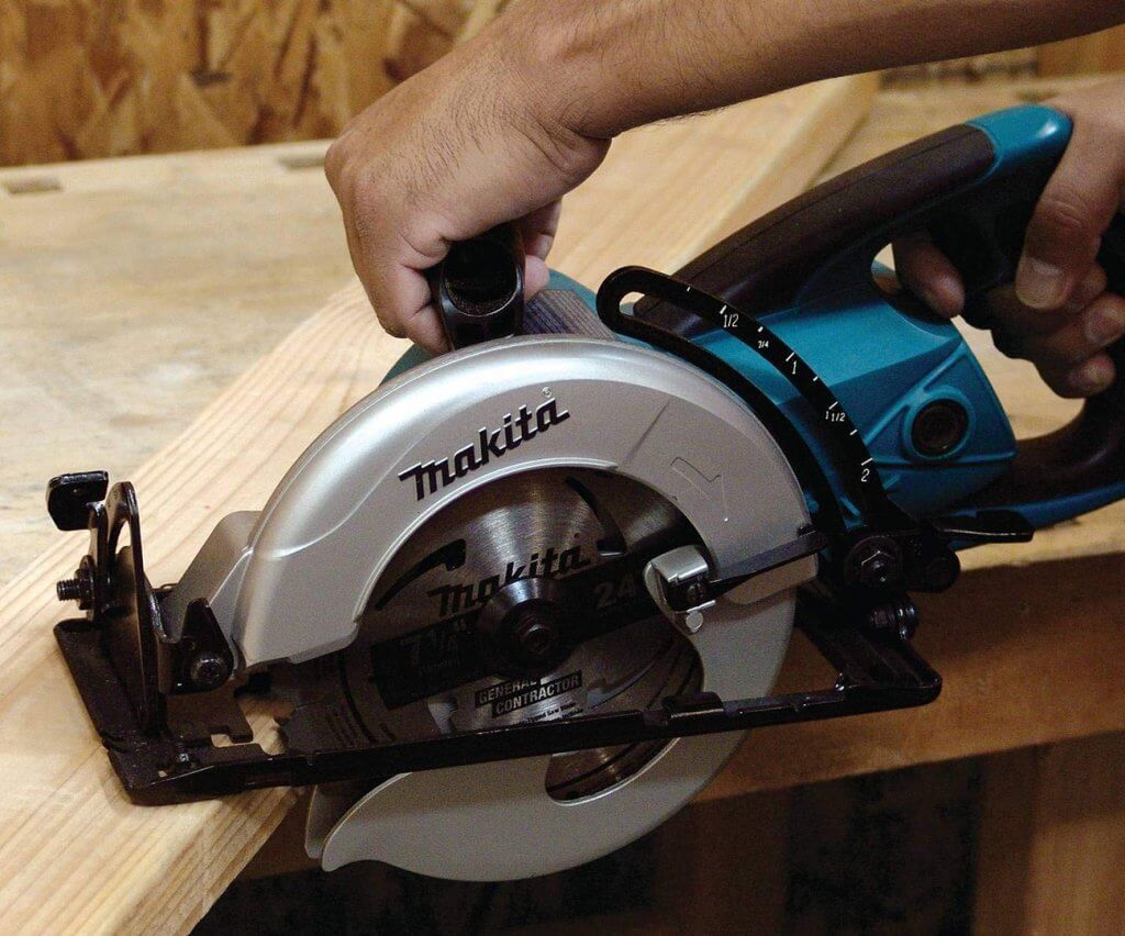 Makita 5477NB Hypoid Saw cutting through board