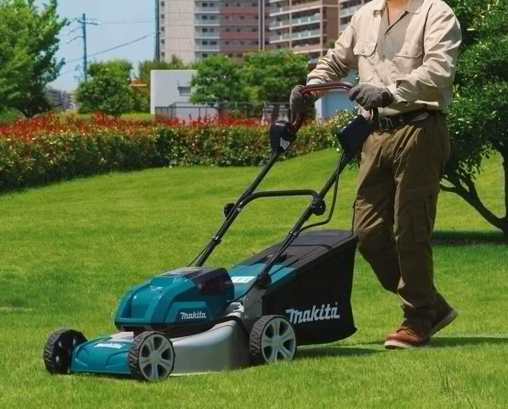 Makita XML03PT1 18-Volt Cordless Lawn Mower on lawn