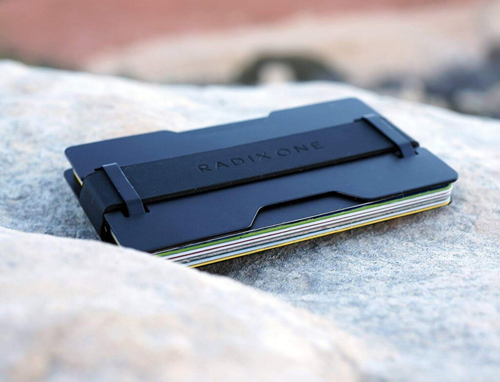 Radix One Black Steel RFID Wallet on stone