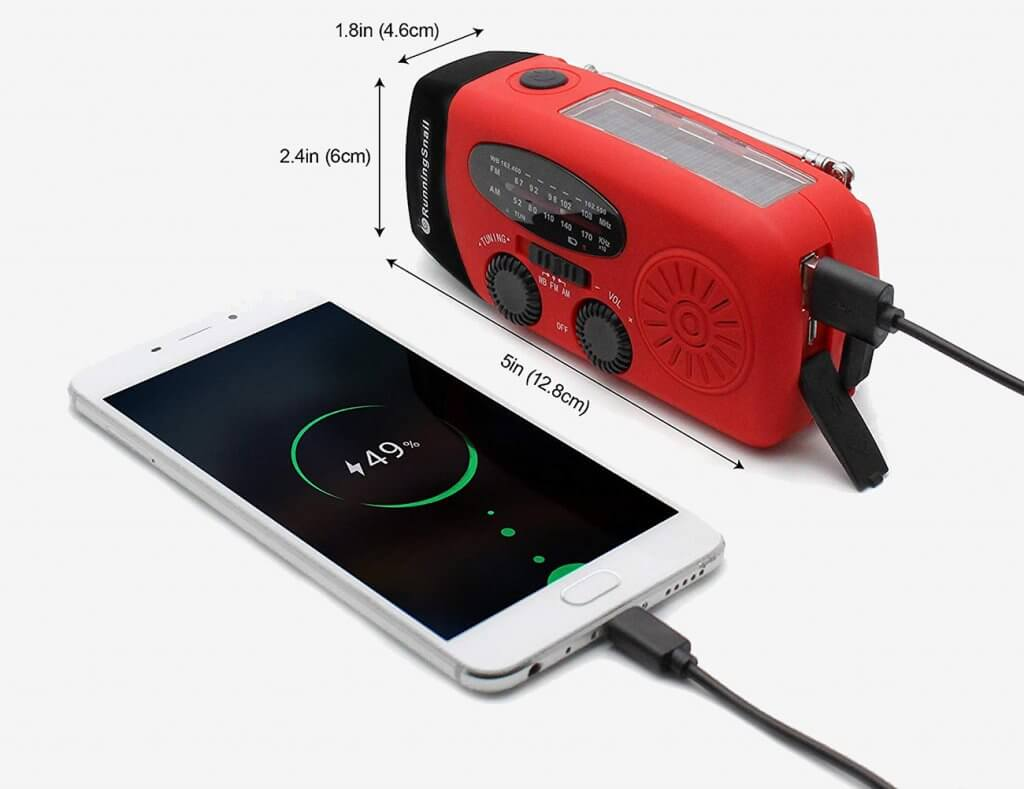 Running Snail survival radio used for charging smartphone