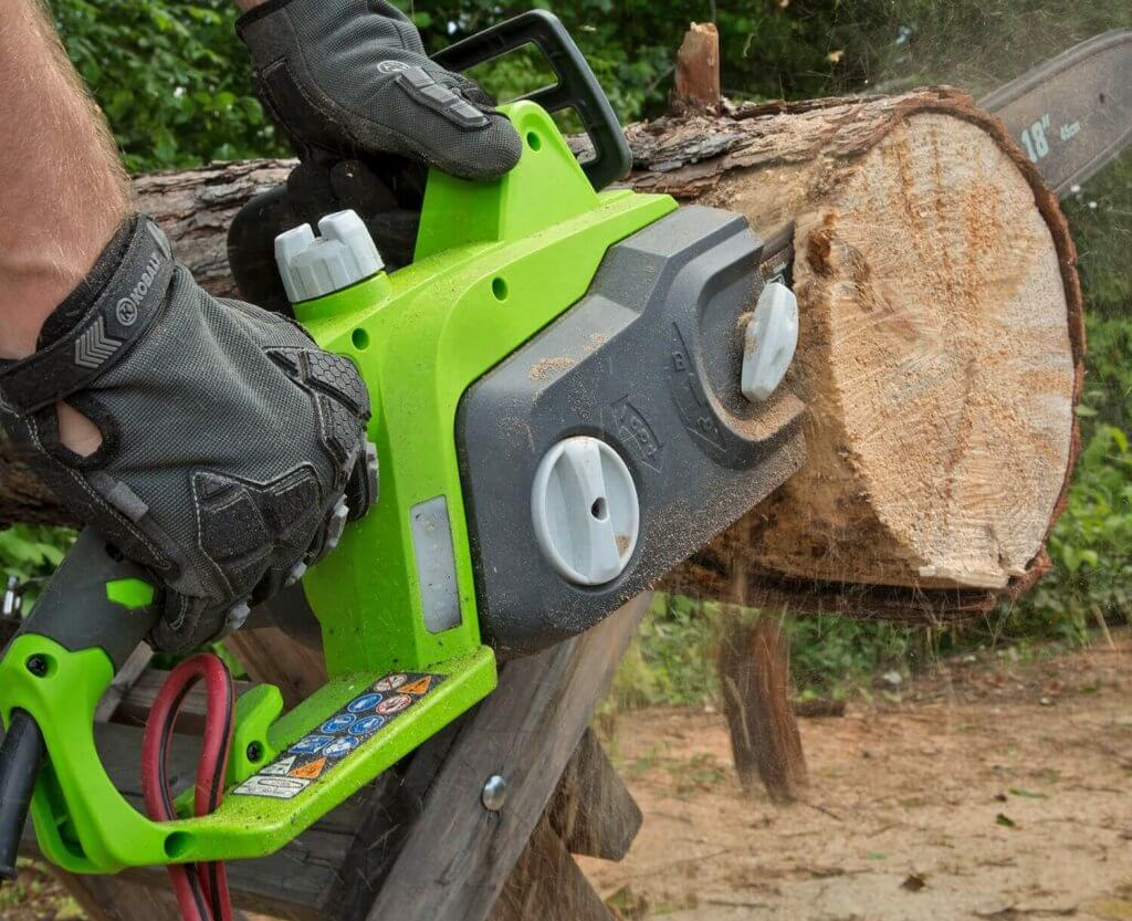 Greenworks 18-Inch Electric Chainsaw cutting a log