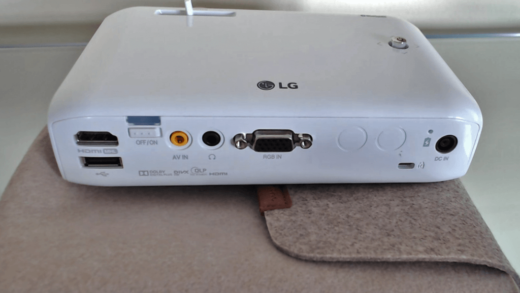 LG PH550 CineBeam LED Mini Projector on bag