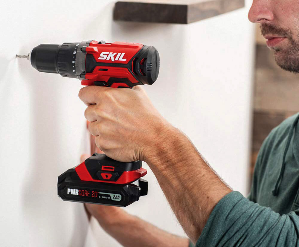 SKIL 20V PWRCore used for drilling a hole in a wall