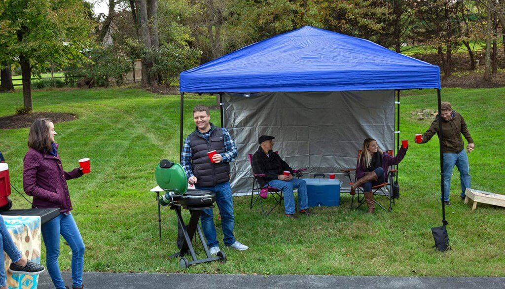Friends doing a BBQ in the Punchau Pop-up Canopy Tent With Sidewall