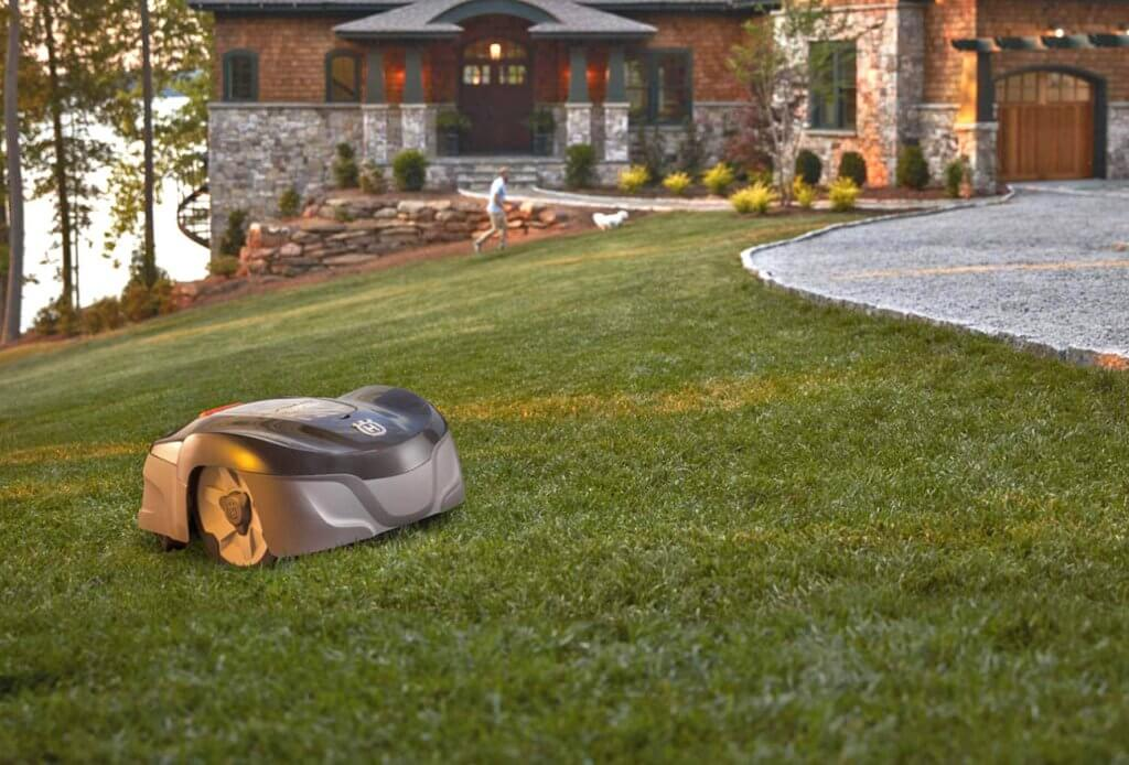 Husqvarna AUTOMOWER 115H on the lawn
