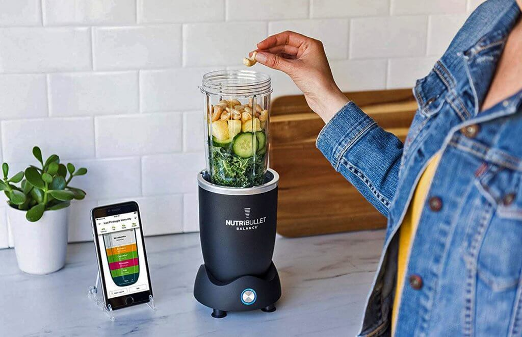 NutriBullet Balance next to a connected smartphone