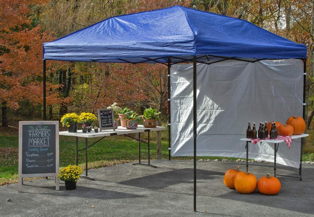 Punchau Pop-up Canopy Tent With Sidewall used for a garden sale