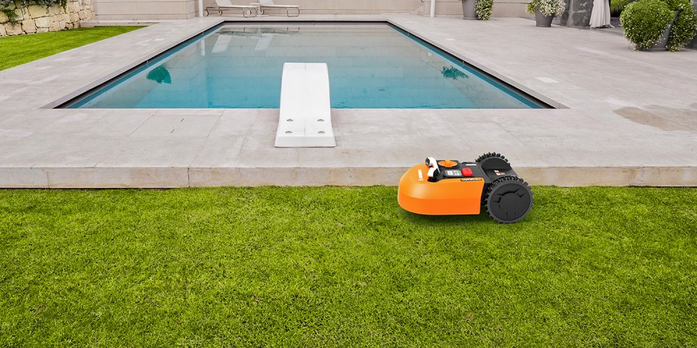 WORX Landroid WR150 in the lawn next to a pool