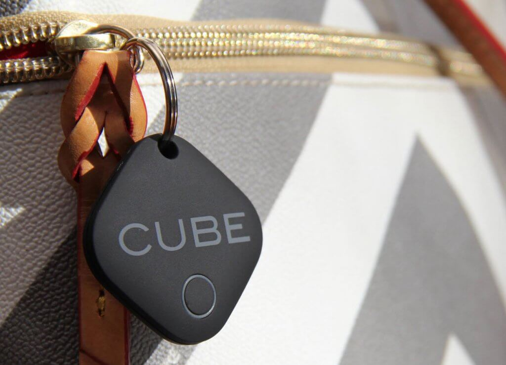 CUBE Smart Tracker on a purse