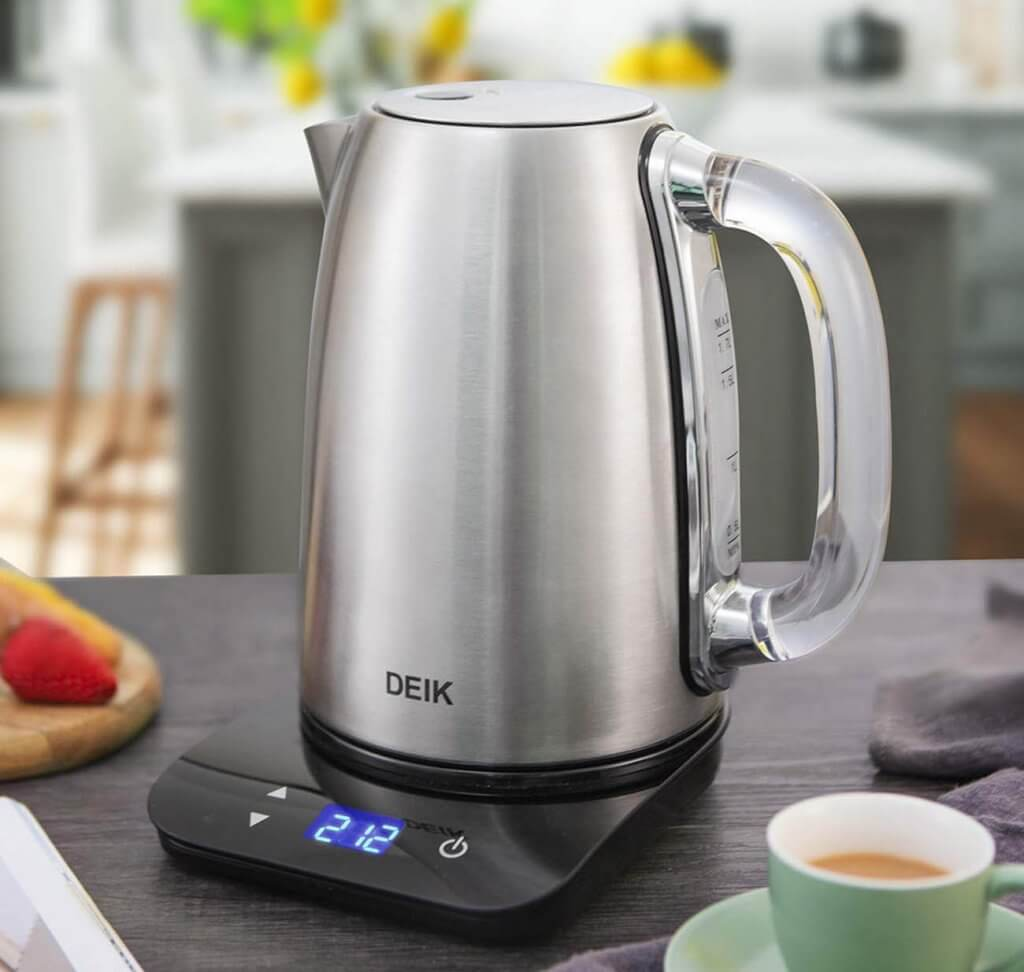 DEIK Electric Kettle in the kitchen next to a cup of coffee