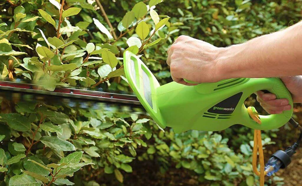Greenworks 18-Inch Hedge Trimmer in action