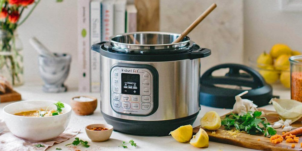Instant-Pot-Duo-Mini-3 on a table with food