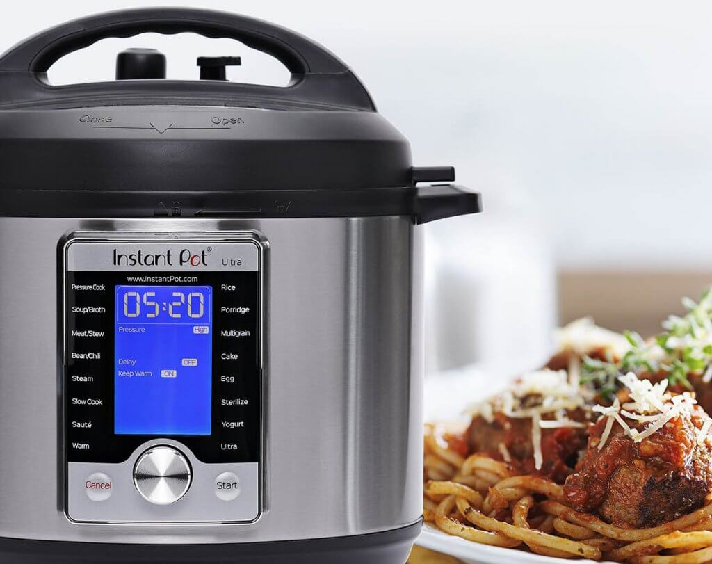 Instant Pot Ultra 10-In-1 Slow Cooker next to a meal