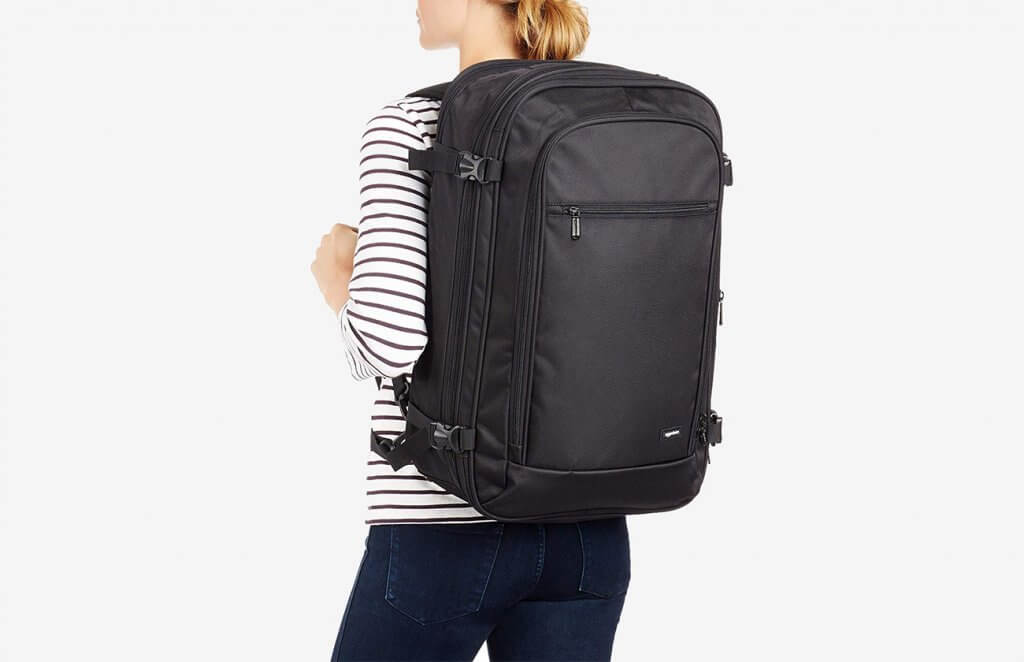 Someone carrying the AmazonBasics Carry-On Travel Backpack