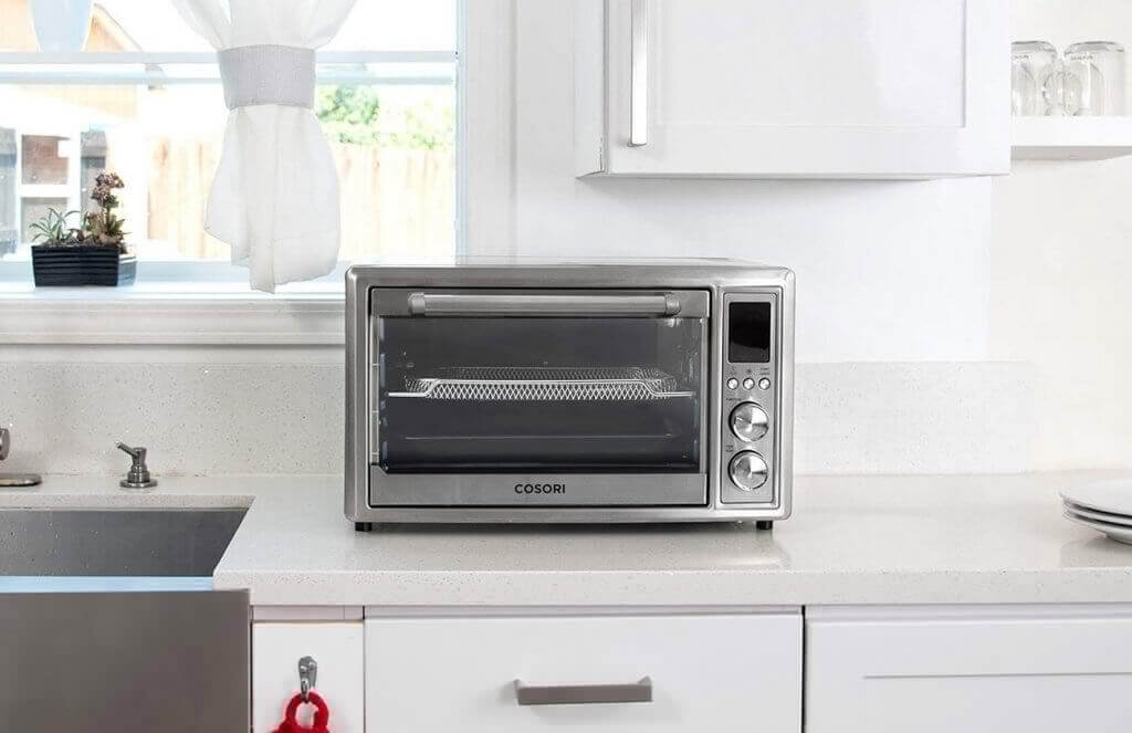 COSORI CO130-AO Air Fryer Toaster Oven on the countertop