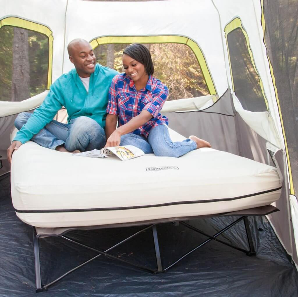 Couple on the Coleman Camping Cot, Air Mattress, and Pump Combo