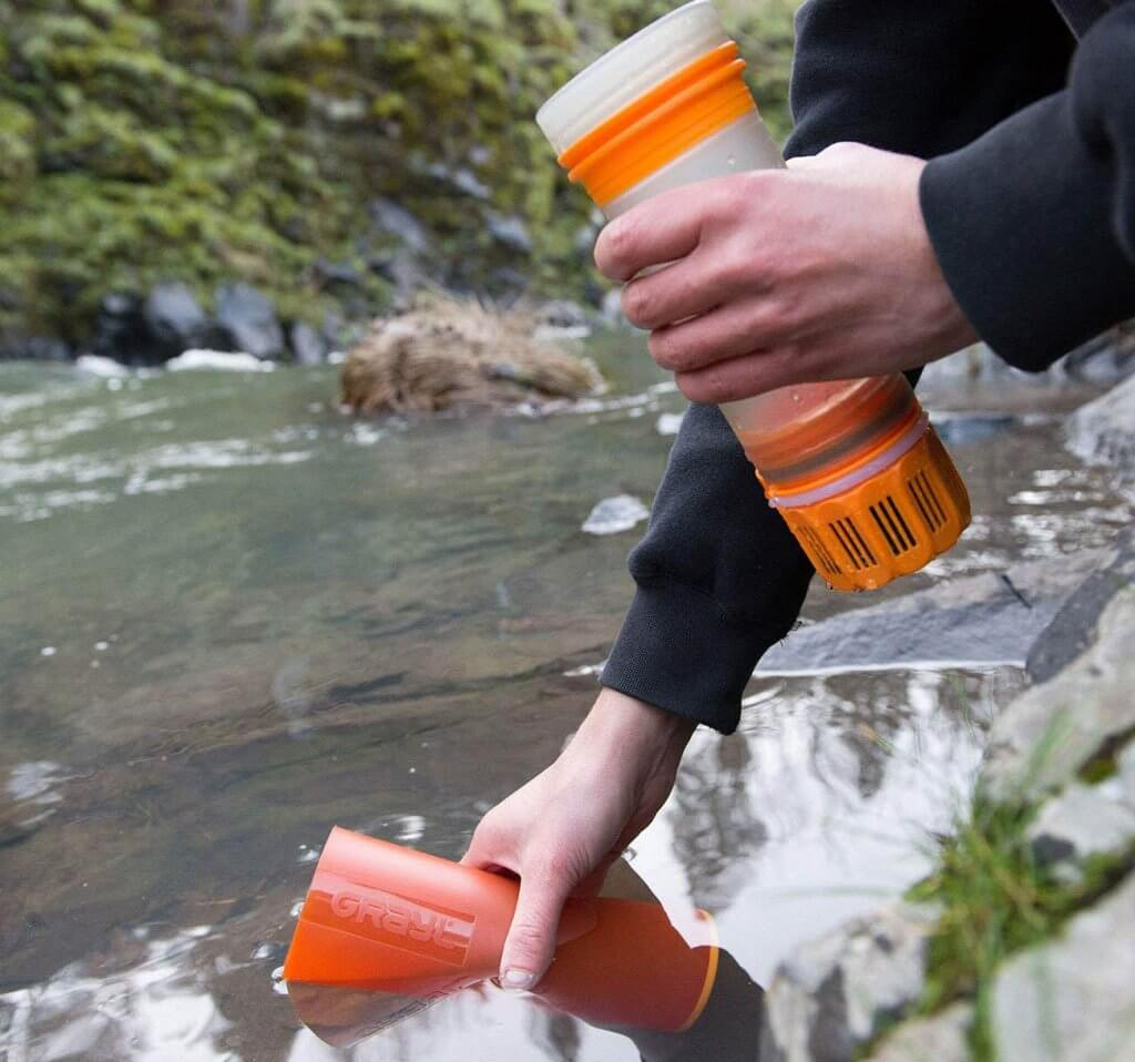 Filling up the GRAYL Ultralight Water Purifier Bottle on a river
