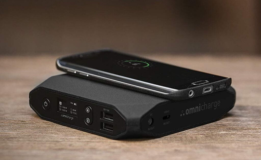 Omni 20+ Portable Power Bank charging a smartphone