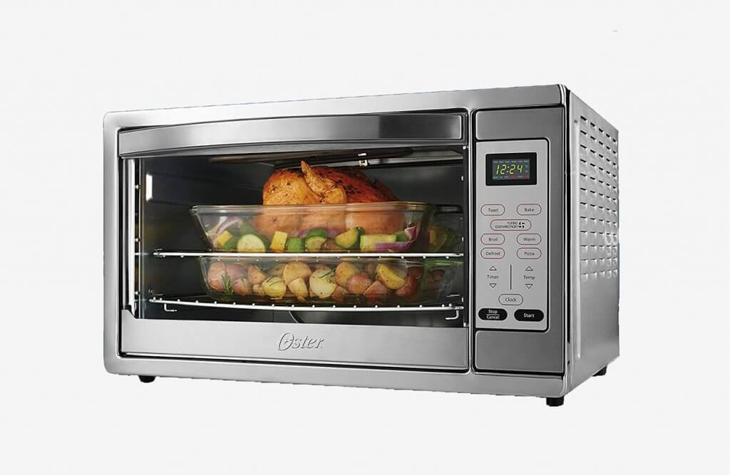 Preparing chicken in the Oster Extra Large Stainless Steel Oven