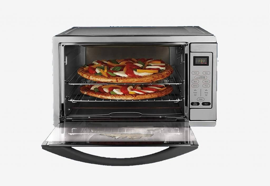 Preparing pizza in the Oster Extra Large Stainless Steel Oven