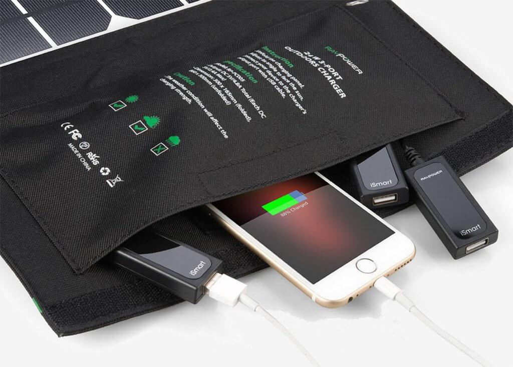 RAVPower 24-Watt Solar Charger and smartphone