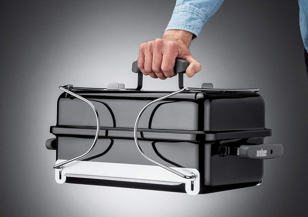 Carrying handle of the Weber 121020 Go-Anywhere Charcoal Grill
