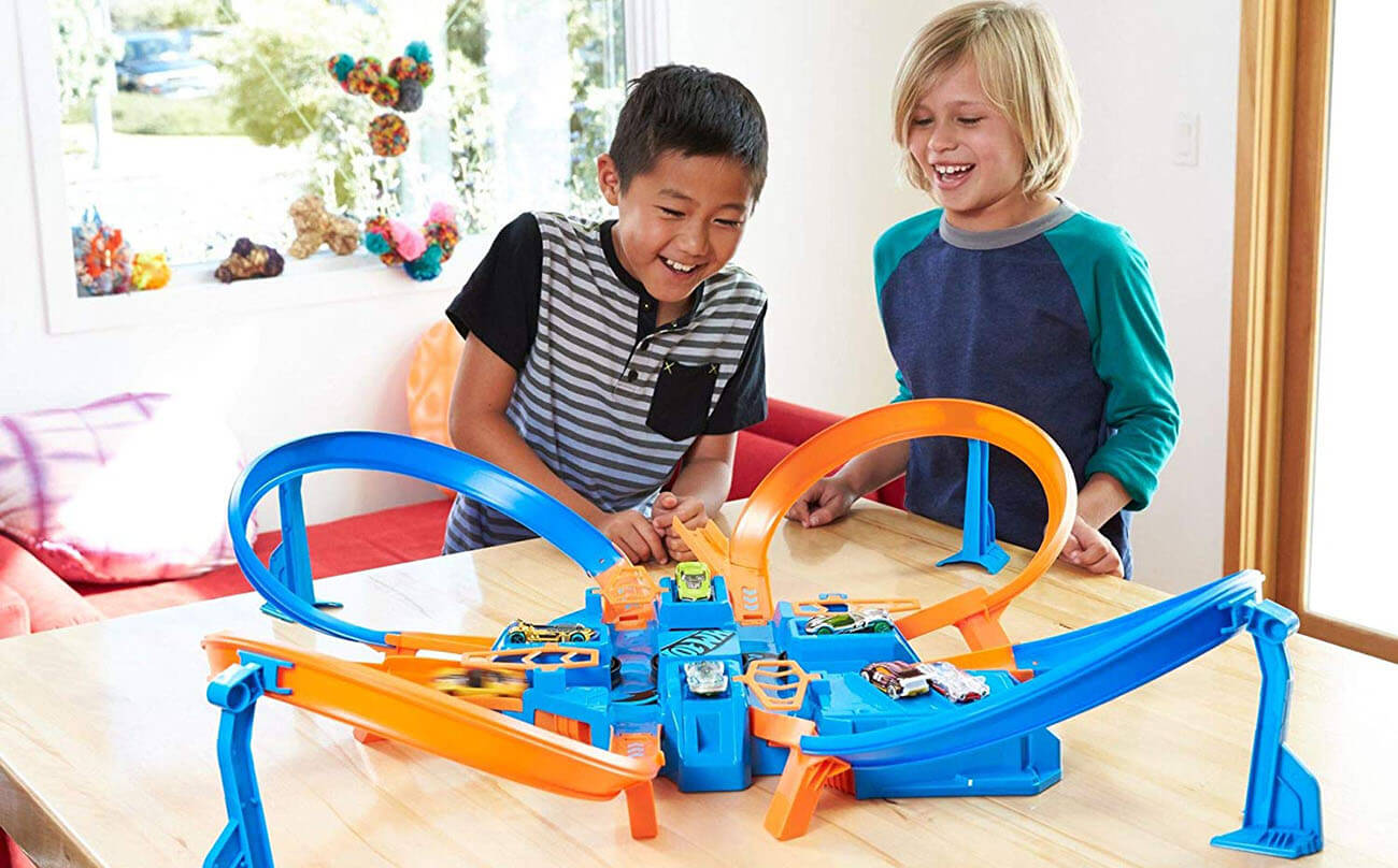 Two boys playing with Hot Wheels