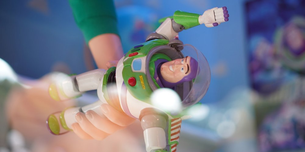 7 year old boy holding Buzz Lightyear toy