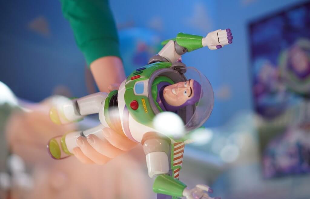 7 year old boy holding Buzz Lightyear toy