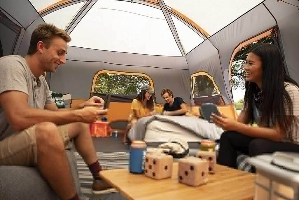 A group of friends in the CORE 12 Person Extra Large Cabin Tent