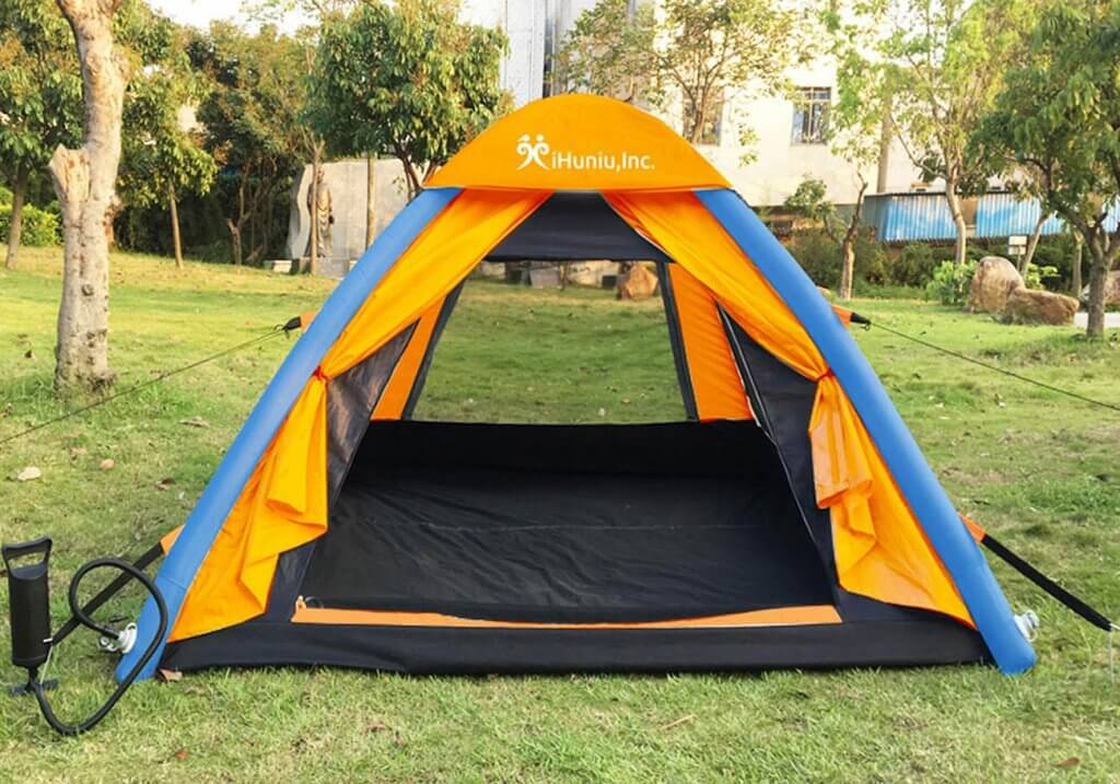 IHUNIU, INC. 4 Person Inflatable Camping Air Tent in the garden