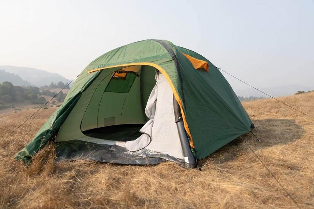 Ryno Tuff Four Person Inflatable Camping Air Tent on a field
