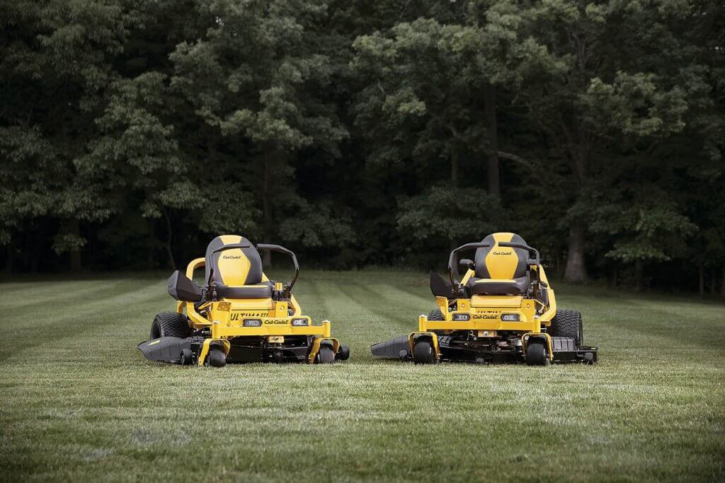 Two Cub Cadet Ultima ZT1 in a big garden