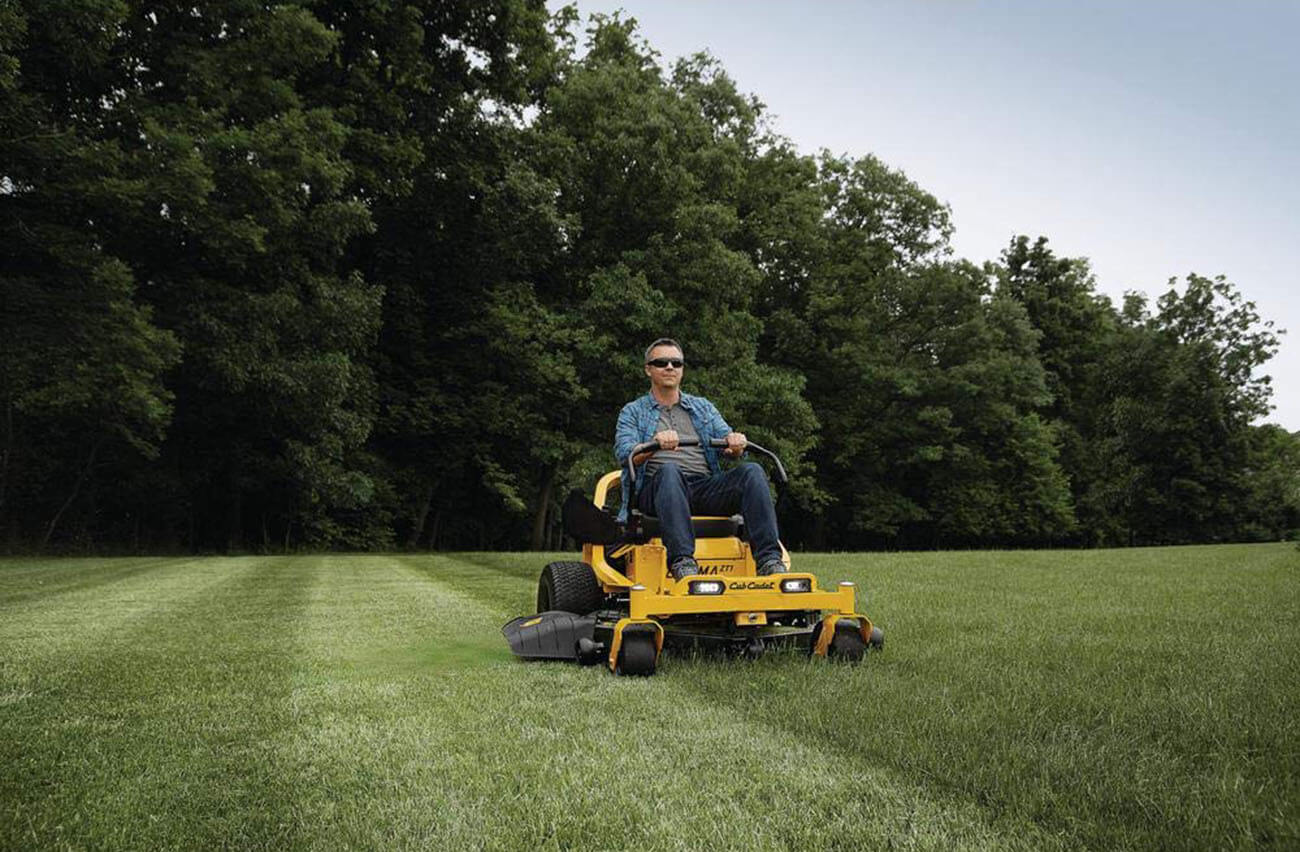 Zero Turn Lawnmower cutting grass
