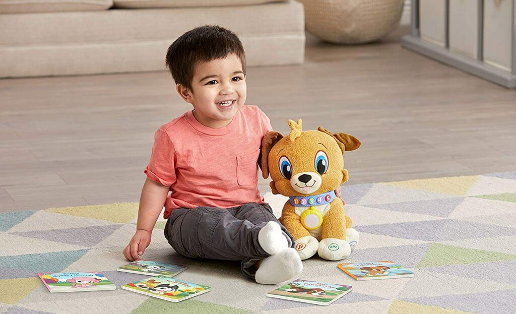 2-Year-Old Boy playing with a toy