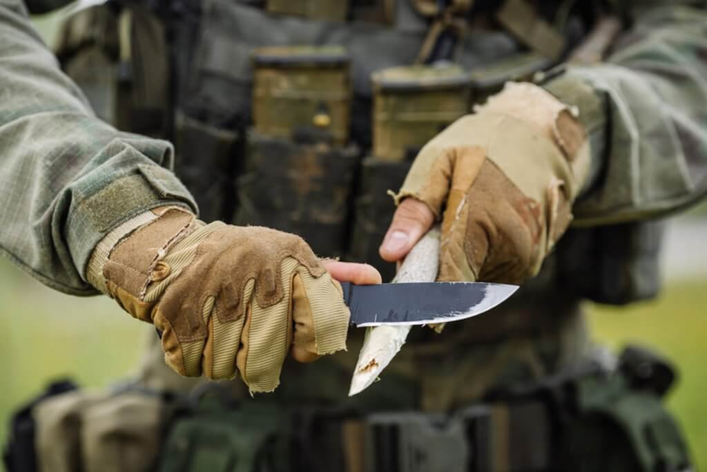 Carving a stick with a Survival Knife