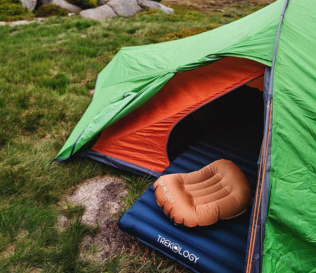 Aluft Ultralight Inflating Travel and Camping Pillow in a tent