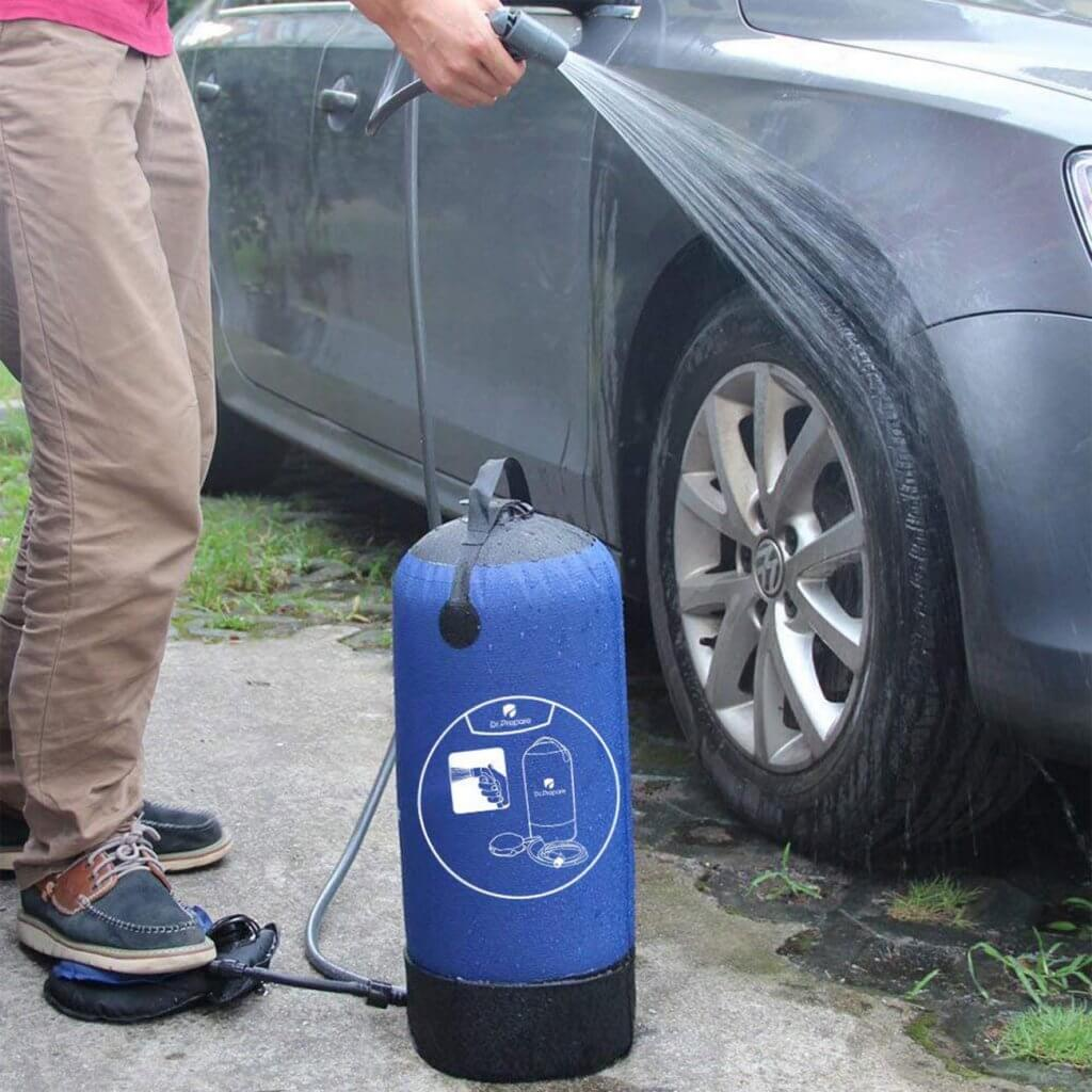 Cleaning a car with the Dr. Prepare Solar Camping Shower