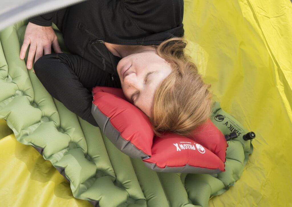 Klymit Pillow X Inflatable Camping And Travel Pillow on mattress