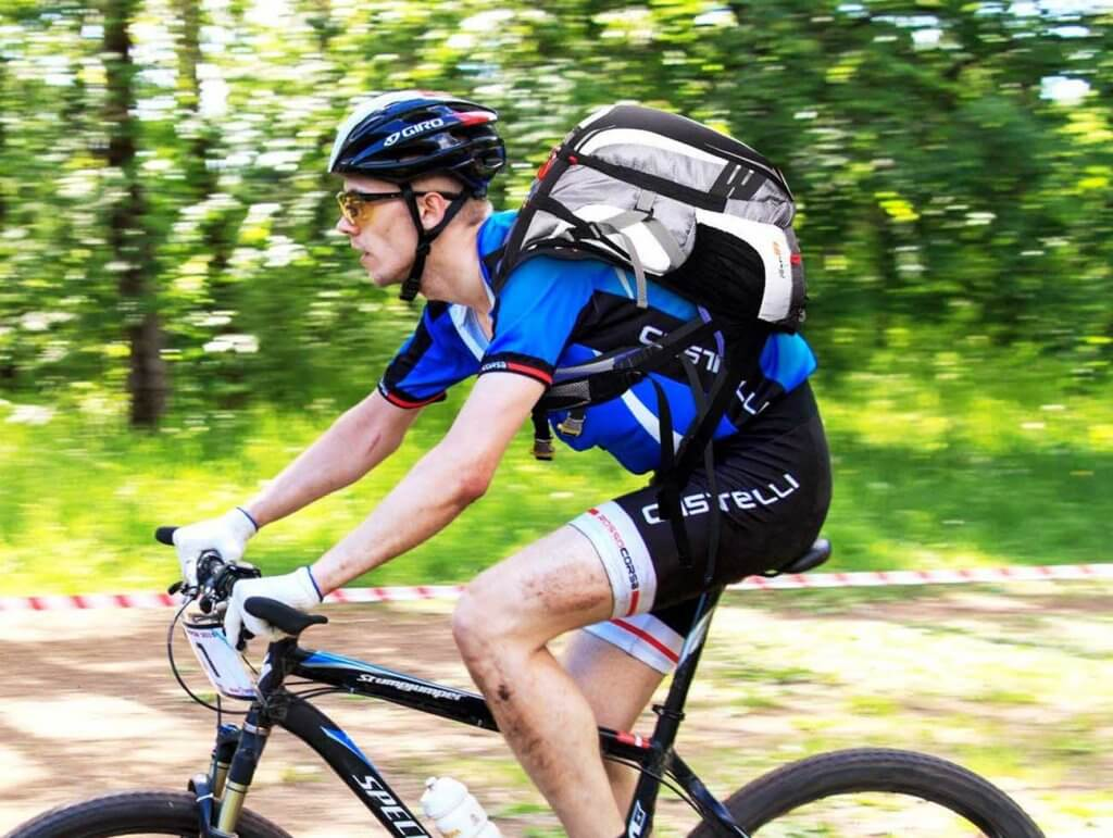 Biker wearing the Local Lion Cycling Backpack