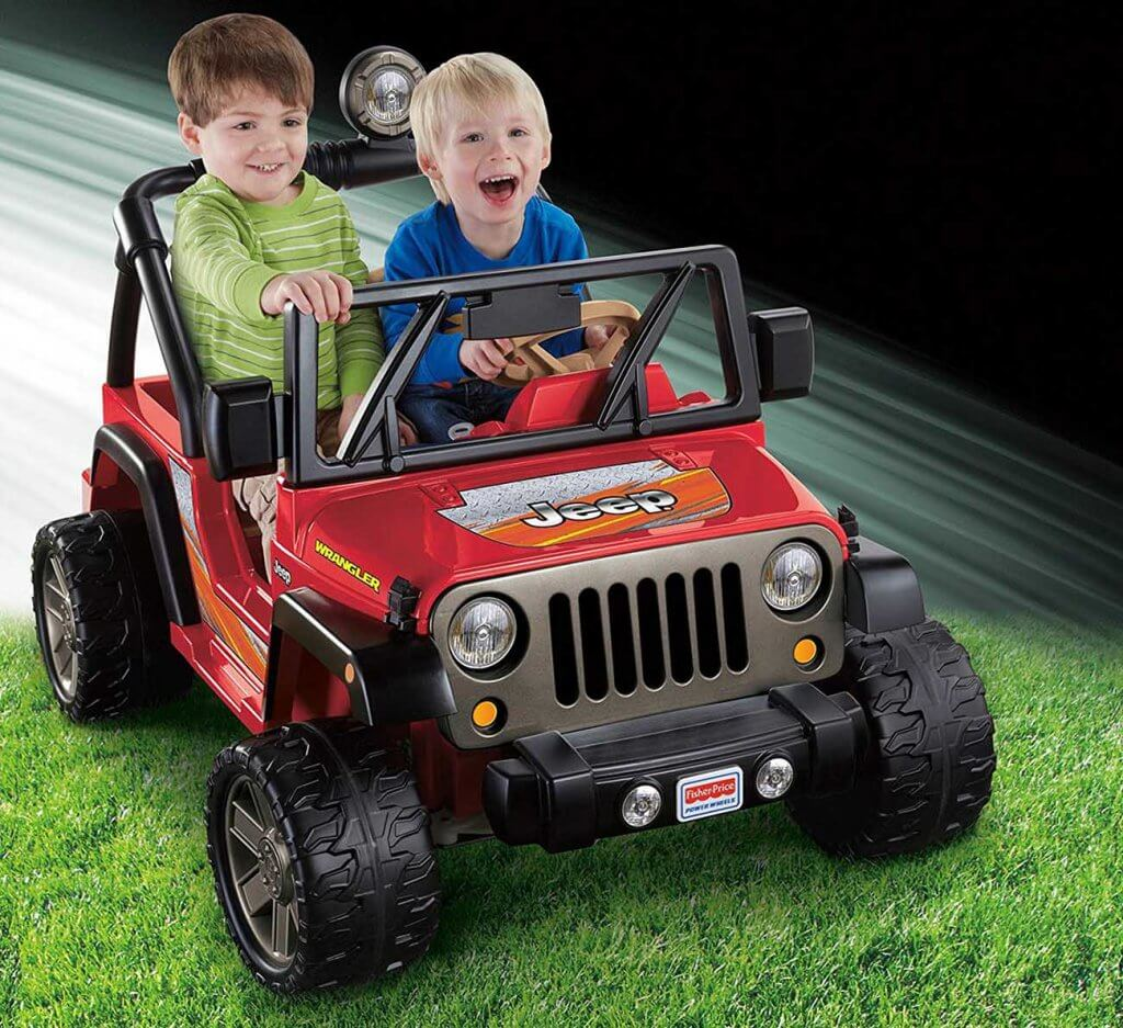 two kids in the Power Wheels Tough Talking Jeep Wrangler