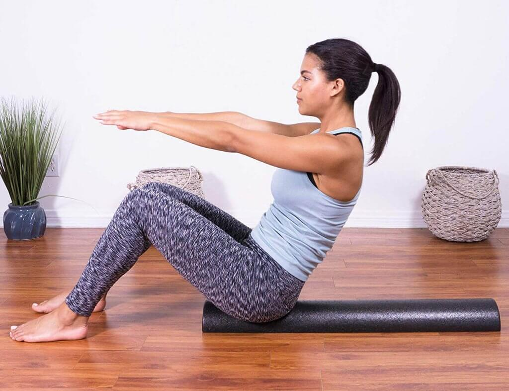 Woman using the ProSource Fit High-Density Half-Round Foam Roller