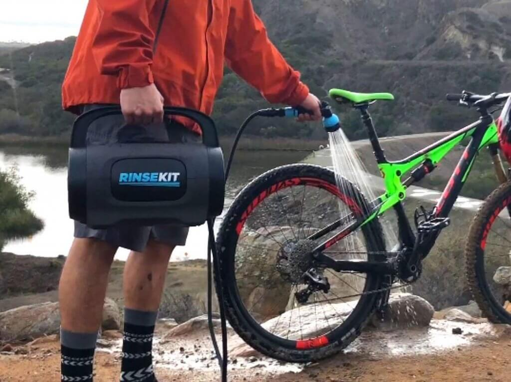 Rinse Kit POD Portable Outdoor Shower used for cleaning a bike