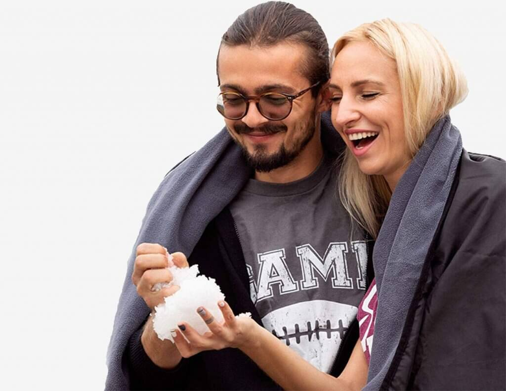 Couple using the SuitedNomad Outdoor Stadium Blanket